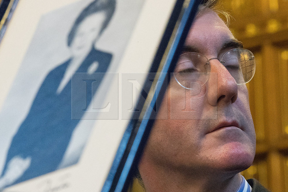 © Licensed to London News Pictures . 02/10/2017. Manchester, UK. JACOB REES-MOGG and a framed portrait of Margaret Thatcher at a fringe , right-wing Bruges Group event at Manchester Town Hall during the second day of the Conservative Party Conference at the Manchester Central Convention Centre . Photo credit: Joel Goodman/LNP