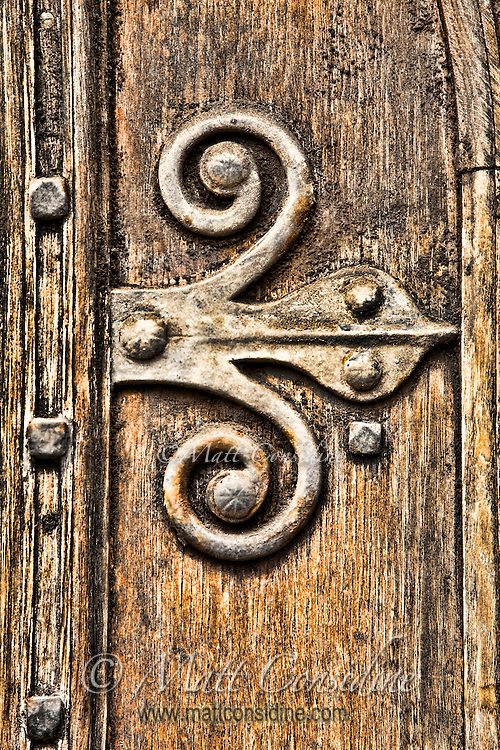 A well weathered old door and hinge in Oxford.