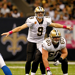 October 23, 2011; New Orleans, LA, USA; New Orleans Saints quarterback Drew Brees (9) signals from under center Brian De La Puente (60) during the first half of a game against the Indianapolis Colts at the Mercedes-Benz Superdome. Mandatory Credit: Derick E. Hingle-US PRESSWIRE / © Derick E. Hingle 2011