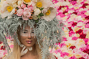 Models wear hats made of Peonies on the Primrose Hall flower stand - The Chelsea Flower Show organised by the Royal Horticultural Society with M&G as its MAIN sponsor for the final year.