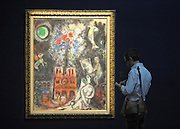 """© Licensed to London News Pictures. 14/06/2012. London, UK A man looks at Marc Chagall's """"L'Arbre de Jesse' estimated to fetch 3-5 MillionGBP. Photocall for Sotheby's June Impressionist and Modern Art Sale this June. Photo credit : Stephen Simpson/LNP"""