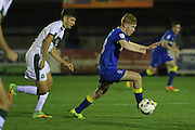 AFC Wimbledon midfielder Alfie Eagan (28) and Plymouth Argyle defender & captain Gary Miller (2) during the EFL Trophy match between AFC Wimbledon and Plymouth Argyle at the Cherry Red Records Stadium, Kingston, England on 4 October 2016. Photo by Stuart Butcher.