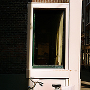 A panoramic view of a bicycle parked against a wall in Amsterdam, Holland. 23rd July 2011. Photo Tim Clayton