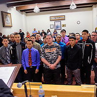032415  Adron Gardner/Independent<br /> <br /> Gallup Bengal boys varsity basketball players listen as Mayor Jackie McKinney presents commendation for their performance at the 2015 New Mexico High School State basketball finals at city hall in Gallup Tuesday.