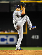 Jul. 15 2011; Phoenix, AZ, USA; Los Angeles Dodgers pitcher Clayton Kershaw (22) delivers a pitch against the Arizona Diamondbacks at Chase Field. The Dodgers defeated the Diamondbacks 6-4.  Mandatory Credit: Jennifer Stewart-US PRESSWIRE..