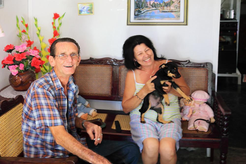 Man and woman with dog in the Campo Florido area of Ciudad de La Habana, Cuba.