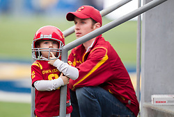 Nov 28, 2015; Morgantown, WV, USA; A young Iowa State Cyclones fan waits for players to enter the field before their game against the West Virginia Mountaineers at Milan Puskar Stadium. Mandatory Credit: Ben Queen-USA TODAY Sports