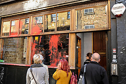 © Licensed to London News Pictures. 27/09/2015. City, UK. The Cereal Killer cafe in Brick Lane bears the aftermath of a paint attack during the previous night by activists protesting against gentrification in London's East End. Photo credit : Stephen Chung/LNP