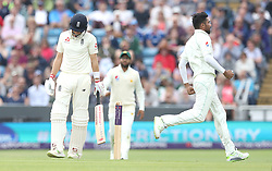 England's Joe Root (left) shows his dejection as Pakistan's Mohammad Amir celebrates taking his wicket during day two of the Second Natwest Test match at Headingley, Leeds.