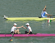 2003 - FISA World Cup Rowing Milan Italy.31/05/2003  - Photo Peter Spurrier.Men's Eight Final. German stroke and Cox left Michael RUHE  and Peter THIEDE, congratulate each other on victory in the men's eight - while the, Italian eight, bowman enjoys personal triumph. . [Mandatory Credit: Peter Spurrier:Intersport Images]
