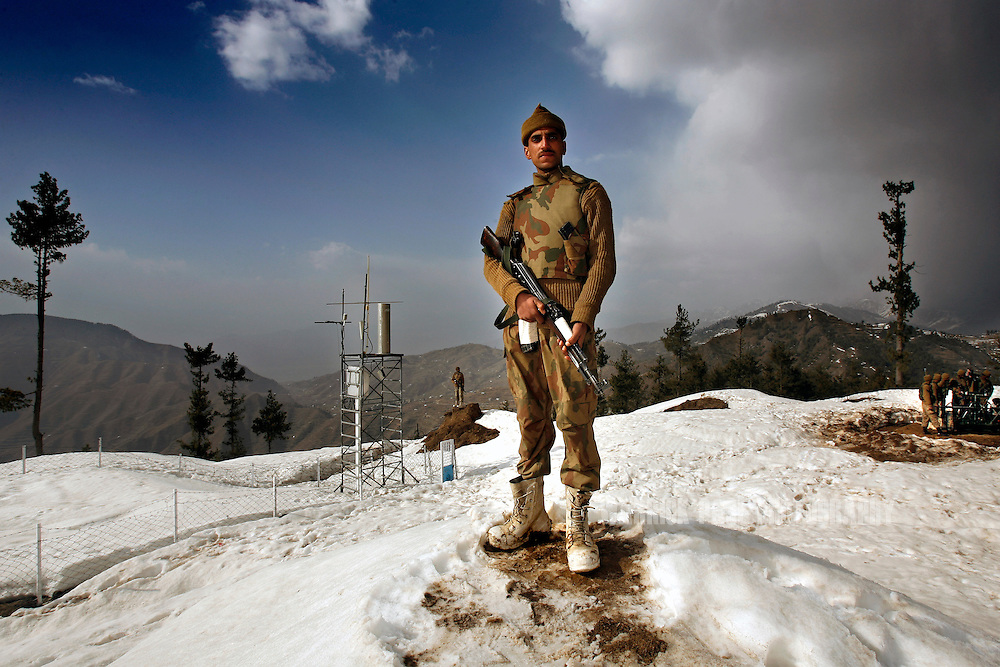 SWAT VALLEY, PAKISTAN - FEBRUARY 25: A Pakistani soldier stands guard at a military outpost on a strategic mountain-top in Shangla on Monday, February 25, 2008, Swat Valley, Pakistan. The Pakistan Army has spent more than three months battling Islamic militants in the Swat Valley, reclaiming large swaths of land, but failing to drive completely the militants from its mountainous landscape. Once a major tourist destination, the Swat valley was overrun last year with Islamic militants intent on imposing hard-line Islamic rule. In November, 2007, the military staged one of its largest operations since its six-year involvement in the war on terror to drive the militants out. Pakistan's ongoing commitment to fighting Islamic militancy and terrorism is unclear with the formation of a new government after recent national elections. . (Photo by Warrick Page)