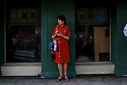 Sandy Galleon a student at University of North Florida studying political communications, tweets her observations as she watches protesters march through the streets of Ybor City during the 2012 Republican National Convention on August 28, 2012.