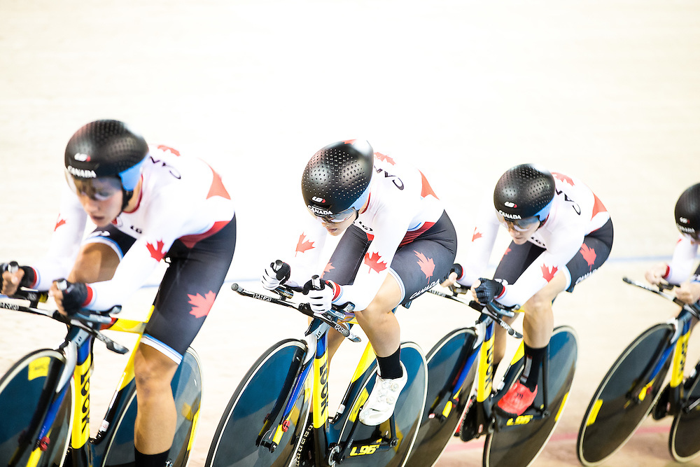 The Canadian team of (L-R) Jasmin Glaesser, Kirsti Lay, Laura Brown and Allison Beveridge compete in the women's team pursuit qualification on the fist day of track cycling at the 2015 Pan American Games in Toronto, Canada, July 16,  2015.  AFP PHOTO/GEOFF ROBINS