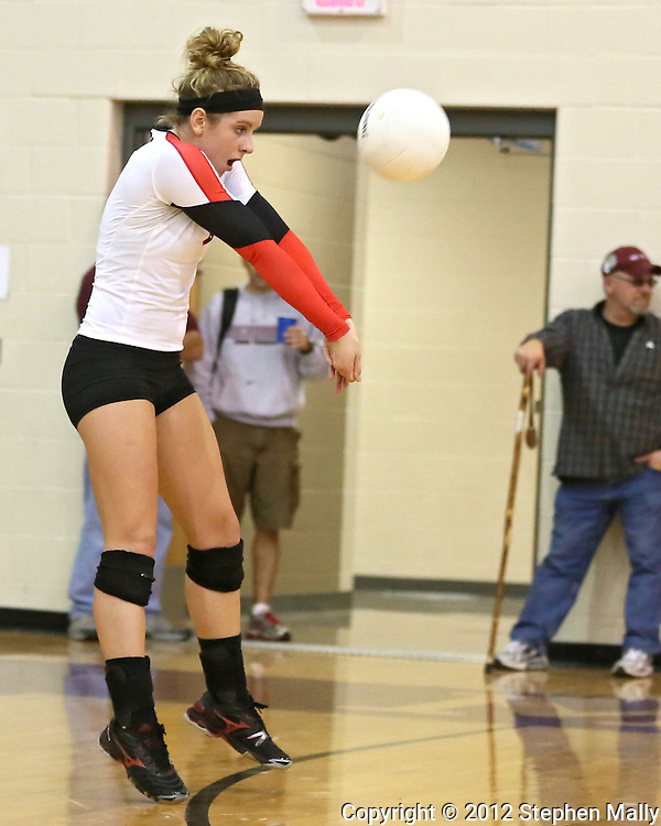 Maquoketa's Aubree Taylor (8) goes for a dig during the WaMaC Tournament Championship game at Mount Vernon High School in Mount Vernon on Thursday October 11, 2012. Solon defeated Maquoketa 17-25, 25-15, 15-10.