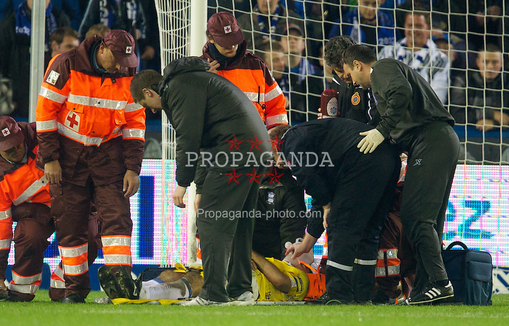 BRUGES, BELGIUM - Thursday, October 20, 2011: Birmingham City's Pablo Ibanez is carried off the pitch in a neck brace after being knocked unconscious during the UEFA Europa League Group H match against Club Brugge at the Jan Breydelstadion. (Pic by David Rawcliffe/Propaganda)