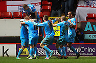 Thomas Kennedy of Barnsley (2nd left)  celebrates scoring his team's second goal to make it 0-2, with team mates, during the Sky Bet Championship match at The Valley, London<br /> Picture by David Horn/Focus Images Ltd +44 7545 970036<br /> 15/04/2014