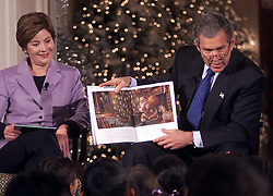 Dec. 10, 2001 - U.S. - KRT US NEWS STORY SLUGGED: BUSH KRT PHOTOGRAPH BY CHUCK KENNEDY/KRT (December 10) WASHINGTON, DC - President George Bush, with First Lady Laura Bush, reads '''Twas The Night Before Christmas'' to fifty first-graders in the East Room of the White House, Monday December 10, 2001. (KRT) NC KD BL 2001 (Horiz) (lde) (Credit Image: © PHOTOGNOSOURCE/TNS/ZUMAPRESS.com)