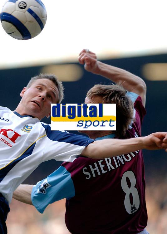 Photo: Daniel Hambury.<br />West Ham United v Portsmouth. The Barclays Premiership. 18/03/2006.<br />West Ham's Teddy Sheringham and Portsmouth's Gary O'Neil battle.