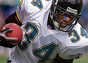Running back Stacey Mack, replacing an injured Fred Taylor, runs for the Jaguar's only touchdown of the day, helping them defeat the Titans 13-6 Sunday in Jacksonville's Alltel Stadium.