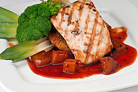 Plate of Mahi Mahi, severd with vegetables, pineapple and soy sauce.