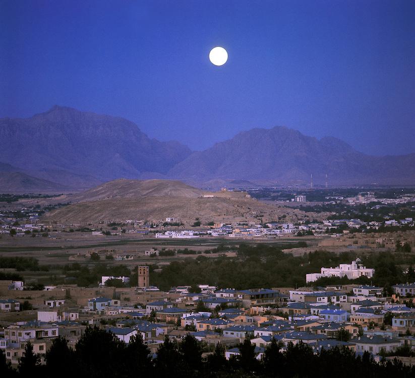 A full moon illuminates the sleeping city of Kabul, Afghanistan's capital.