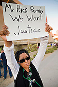 11 OCTOBER 2010 - PHOENIX, AZ:  MARISOL MARQUEDA, from Phoenix, pickets Phoenix police headquarters Monday night. Rick Romley is the county attorney who will files charges against the police officer. About 300 people gathered at the Phoenix Police Department headquarters building Monday night to protest the shooting of Daniel Rodriguez and his dog. The officers responded to a 911 call made by Rodriguez' mother. A scuffle ensued when they arrived and Phoenix police officer Richard Chrisman shot Rodriguez, who was unarmed, and his dog. Chrisman then allegedly filed a false report about the event. He has been arrested on felony assault charges. The event has angered some in the Latino community and they have held a series of protests at the police headquarters. They want Chrisman charged with murder.    Photo by Jack Kurtz