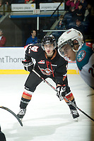 KELOWNA, CANADA, JANUARY 1: Calder Brooks #19 of the Calgary Hitmen faces off as the Calgary Hitmen visit the Kelowna Rockets on January 1, 2012 at Prospera Place in Kelowna, British Columbia, Canada (Photo by Marissa Baecker/Getty Images) *** Local Caption ***