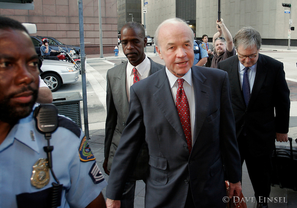 HOUSTON  - MAY 22:  Former Enron chairman Kenneth Lay, followed by his attorney George Secrest (R), arrives at the Bob Casey U.S. Courthouse for his bank fraud trial May 22, 2006 in Houston. Lay is charged with one count of bank fraud and three counts of making false statements to Bank of America, Chase Bank of Texas and Compass Bank. (Photo by Dave Einsel)