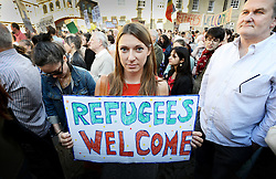 © London News Pictures. 06/09/2015. Demonstration  outside the Sheldonian building in Oxford against the UK's official stance on the refugee crisis - participants are calling for the UK to take up a more proactive role and take in/support more refuges from Syria and around the world.  Photo credit: Richard Cave/LNP