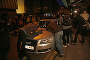 Paparazzi photographing Noel Gallagher leaving in his car, Exhibition of photographs by NME photographer Lawrence Watson. Studio 2. Redchurch St. London. 26 April 2007.  -DO NOT ARCHIVE-© Copyright Photograph by Dafydd Jones. 248 Clapham Rd. London SW9 0PZ. Tel 0207 820 0771. www.dafjones.com.