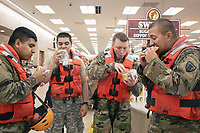 From left, Pfc. Victor Ochoa, Spc. Edgar Duarte, Spc. James Sego and Pfc. Emmit Morgan devour brisket sandwiches at the Buc-ee's in Katy, Texas. The group had been responding to evacuation calls in the area.<br /> <br /> The National Guard continues to patrol waters and evacuate residents from the Houston area.