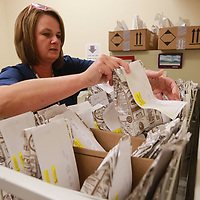 Angela Burdine puts another perscription order away at Lifecore in Tupelo.