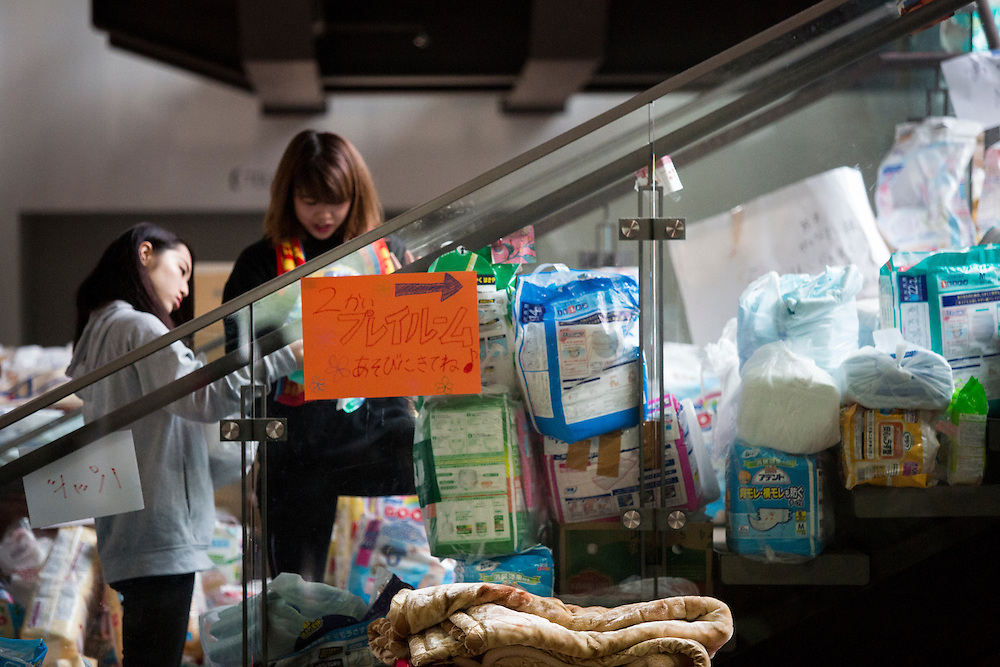 KUMAMOTO, JAPAN - APRIL 21: Young volunteers help organize the supply for victims of earthquake in the morning of April 21, 2016 in Mashiki Gymnasium evacuation center, Kumamoto, Japan. To date 45 people are confirmed dead and around 11,000 people have evacuated after an 6.5 earthquake on Thursday night and a stronger 7.3 quake on Saturday morning struck the Kyushu Island in western Japan.<br /> <br /> Photo: Richard Atrero de Guzman