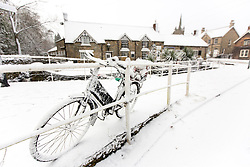 © Licensed to London News Pictures. 30/11/2017. Thornton Le-Dale UK. Picture shows a snow covered bicycle this morning after a night of heavy snow this in the village of Thornton Le-Dale in North Yorkshire.Photo credit: Andrew McCaren/LNP