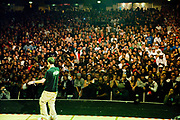 A mc performing on stage with big crowds of audiences. UK B-Boy championships 06. 08/10/2006