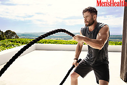 "Chris Hemsworth shared his grueling workout routine in a revealing photoshoot for Men's Health. The Thor actor showed off his bulging biceps on the cover of the fitness mag, which is due to hit US newsstands on February 12. The March edition is also set to go on sale in the UK and Australia. During the photo shoot, which was taken in Byron Bay, Australia, the movie star shared a number of fitness tips. He also recorded a short video detailing his routine, which includes push-ups, battle ropes, medicine ball slams and Russian twists. During an interview with the magazine, he also went on to say that he nearly gave up on acting after missing out on the role of Captain Kirk in 2009's Star Trek. He said"" ""I was about to quit. I always wanted to act, and one of the first things I wanted to do when I got any money was pay my parents' house off. I'd asked Dad once when he thought he'd pay it off and he said, ""Honestly, probably never."" I wanted to change that. So I was super active with auditions. And then my mentality changed, which came from being at a point where I was like, ""I'm going to go back to Australia."" I had one more audition where I was like, ""Do this for his house. Think about reasons other than yourself."" That was for The Cabin in the Woods, and I got that job, and from there I got Red Dawn. And then I got Thor."" He also claimed that he always likes to maintain his physique in case he is ever caught off guard by the paparazzi, adding: ""It comes hand in hand with the roles I play, but look, occasionally you'll see paparazzi poking out of the bushes and you're like, ""How's my rig look? Am I on point, or have I slacked off lately?"" I maintain my fitness because it makes me feel better."" Hemsworth also spoke about his new fitness app Centr, which he hopes will help revolutionize fitness. He said "" ""The whole thing was about not becoming stagnant. That's when your emotional and physical problems occur, I think. I wanted to"