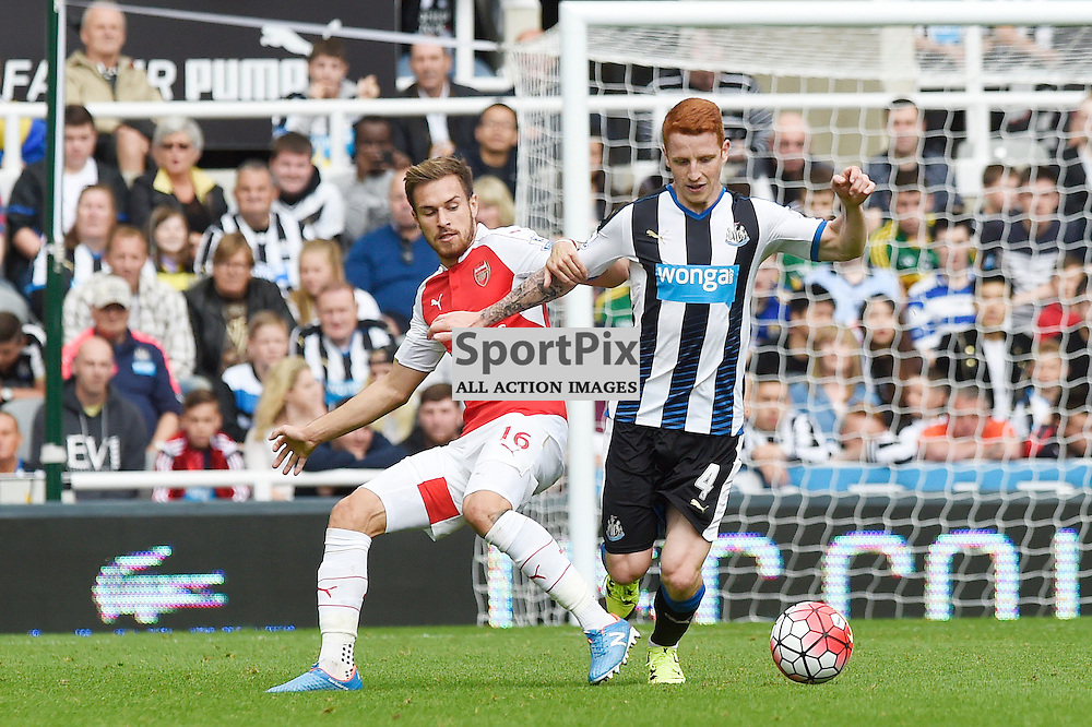 Aaron Ramsey (left) and Jack Colback (right) in the Newcastle United v Arsenal Barclays Premier League match at St James' Park Newcastle 09 August 2015<br /> <br /> (c) Greg Macvean / SportPix.org.uk