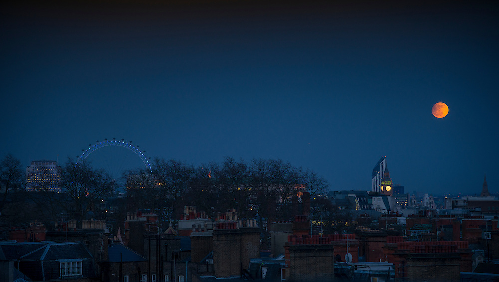 View of the London Skyline with a full moon, Big Ben and the Eye visible from Park Lane
