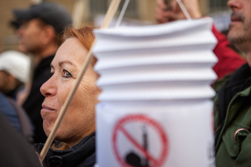Supporters of Czech President Milos Zeman holding a lantern with an anti islam logo during an anti-Islam rally in Prague. Czech Republic celebrates that day the 26th anniversary of the Velvet Revolution which took place in 1989.