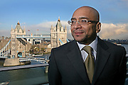Lee Jasper, Senior Policy Advisor on Equalities for the Mayor of Greater London stands in front of Tower Bridge, London.
