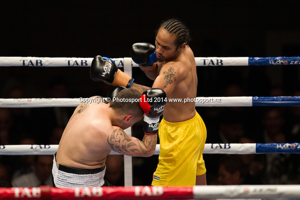Sam Loli on top as he fights Jake Paul at the Hydr8 Zero Heavyweight Explosion, Vodafone Events Centre, Auckland, New Zealand, Saturday, July 05, 2014. Photo: David Rowland/Photosport