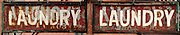 A diptych of the front and back of a laundry sign handing outside a laundromat in the Chelsea neighborhood of Manhattan, New York City.