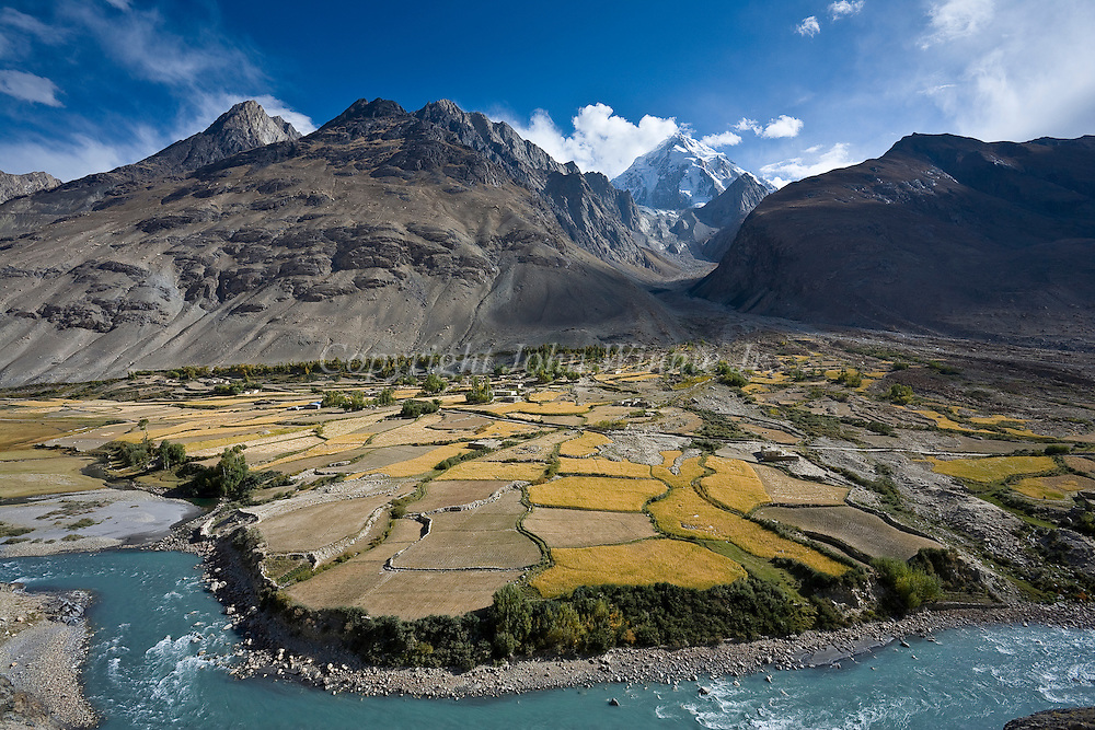 Village of Kret during the wheat harvest. Buba Tengi in the background. Wakhan corridor, Afghanistan.