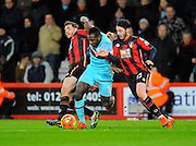 West Ham Utd midfielder Michail Antonio is fouled by AFC Bournemouth midfielder Dan Gosling and AFC Bournemouth defender Adam Smith which led to West Hams third goal during the Barclays Premier League match between Bournemouth and West Ham United at the Goldsands Stadium, Bournemouth, England on 12 January 2016. Photo by Graham Hunt.