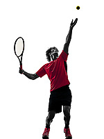 one caucasian hispanic tennis player man in studio silhouette isolated on white background