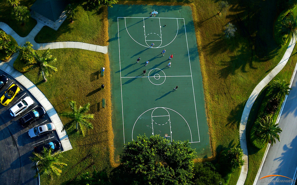 Aerial of outdoor basketball court in the City of Weston.... early morning light