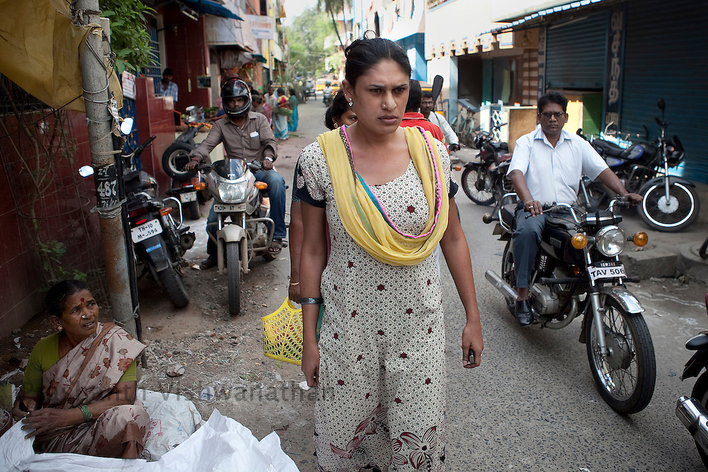Sapita an Aravani ( eunuch) walks through a locality outside her slum house as other passerby look on in Chennai, India, on Friday January 14, 2011. Transgender people are called hijras in India and are often discriminated against in jobs forcing them to resort to begging and prostitution. They meet in Koovagam, a village in the Ulundurpet taluk in Villupuram district, Tamil Nadu in the Tamil month of Chitrai (April/May) for an annual festival which takes place for fifteen days..Tamil Nadu has an estimated population of 30,000 transgender people.[1] It has made great strides in trying to integrate transgender people into society. This includes welfare schemes initiated by the Government and acceptance of transgender people into the mainstream media and film industry.Photographer: Prashanth Vishwanathan/HELSINGIN SANOMAT