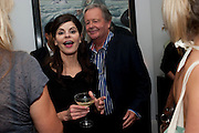 JUSTINE GLENTON; IAN GLENTON, Party at the home of Amanda Eliasch in Chelsea after the opening of As I Like it. A memory by Amanda Eliasch and Lyall Watson. Chelsea Theatre. Worl's End. London. 4 July 2010<br /> <br />  , -DO NOT ARCHIVE-© Copyright Photograph by Dafydd Jones. 248 Clapham Rd. London SW9 0PZ. Tel 0207 820 0771. www.dafjones.com.