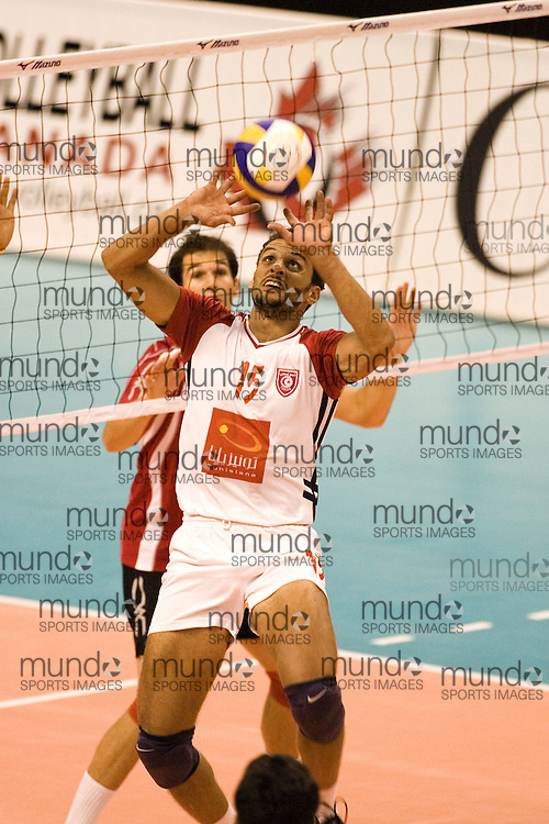 Ghazi Guidara of Tunisia defeating Canada Two three games to none in the 2006 Anton Furlani Volleyball Cup, held in Ottawa, Canada. .Anton Furlani Cup.Copyright Sean Burges / Mundo Sport Images, 2006