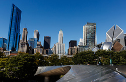 The Chicago skyline including the Frank Gehry designed Jay Pritzker Pavilion from the Frank Gehry designed BP Pedestrian Bridge